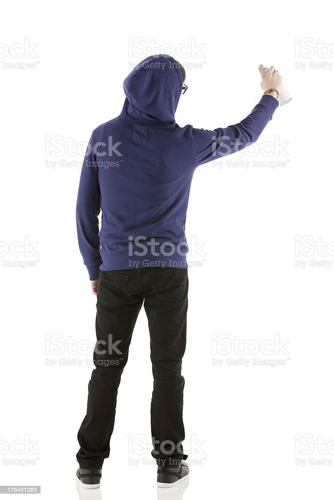 Rear view of a man doing graffiti stock photo
