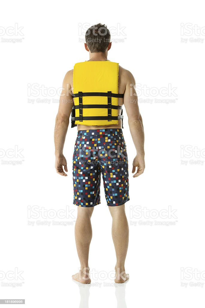 Rear view of a man in life jacket royalty-free stock photo