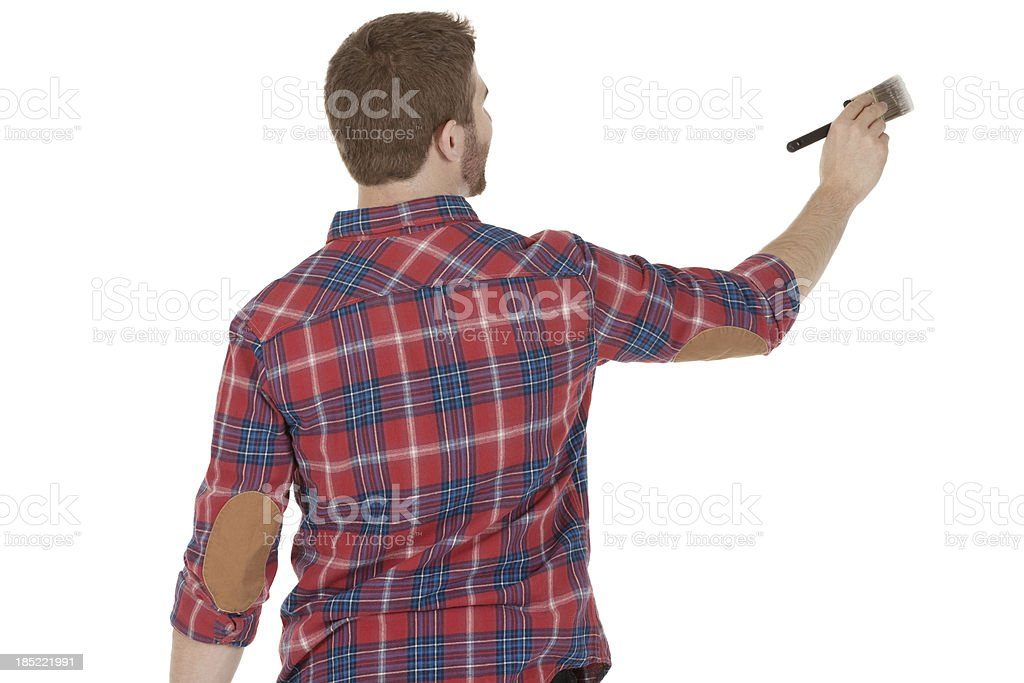 Rear view of a man painting royalty-free stock photo