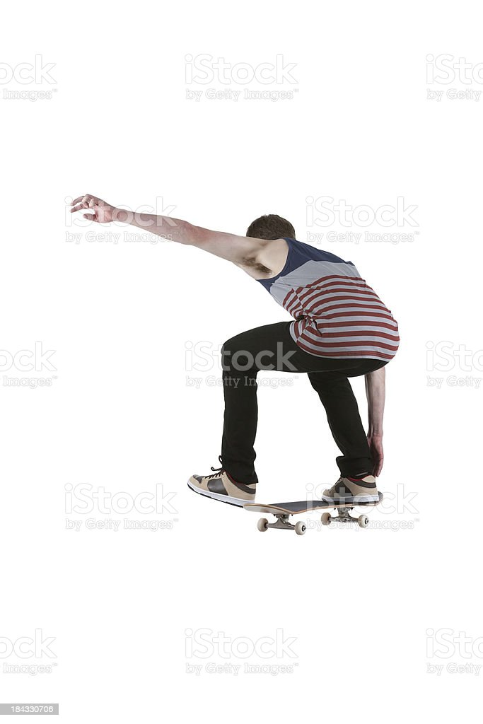 Rear view of a man performing stunt on skateboard royalty-free stock photo