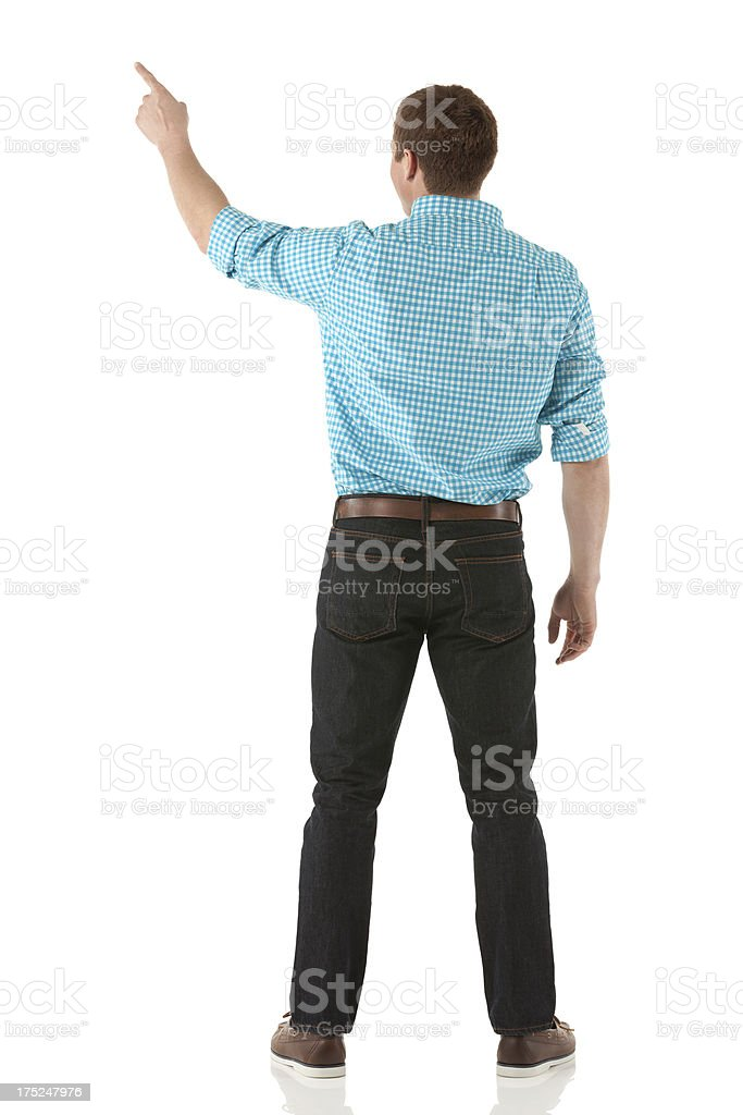 Rear view of a man pointing royalty-free stock photo