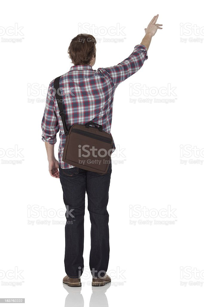 Rear view of a man pointing with finger stock photo