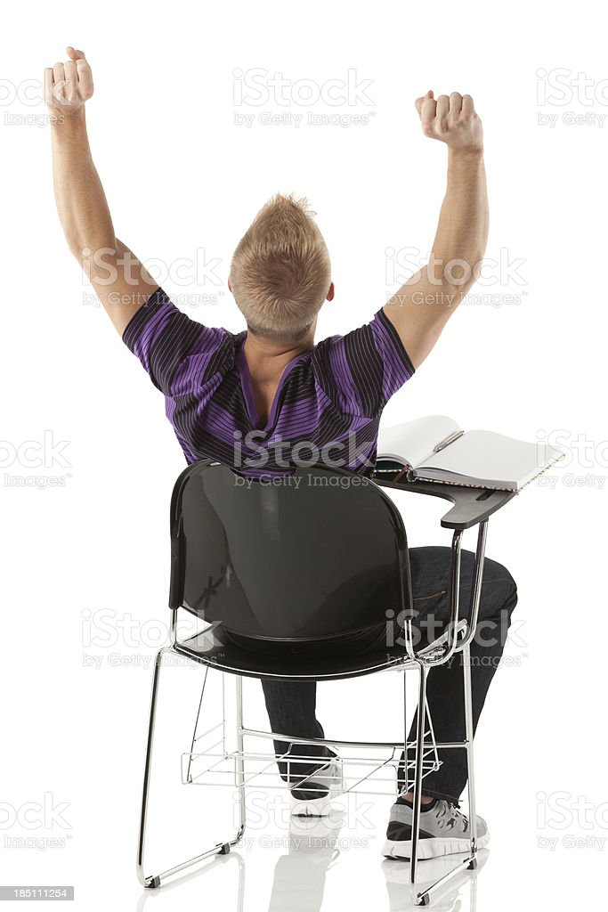 Rear view of a man sitting in an armchair stock photo