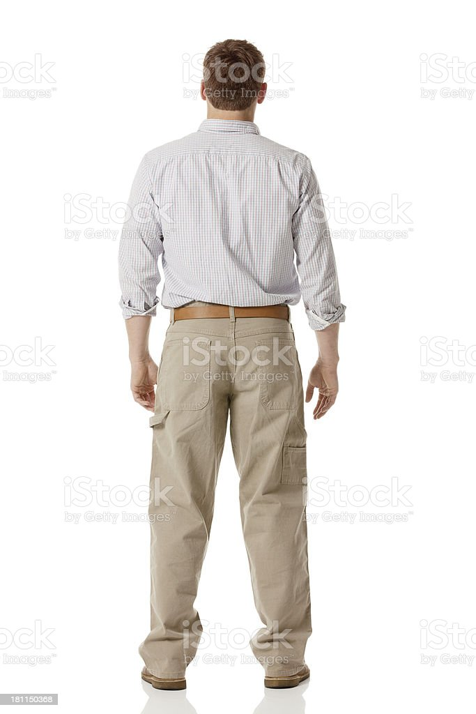 Rear view of a man standing stock photo
