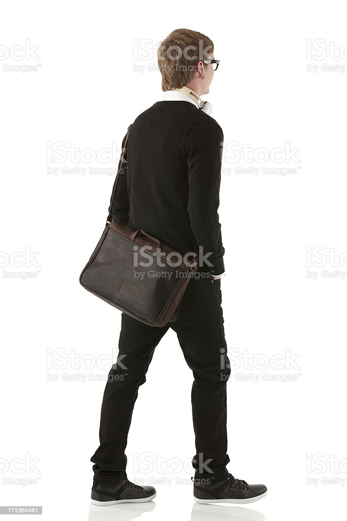 Rear view of a man walking royalty-free stock photo