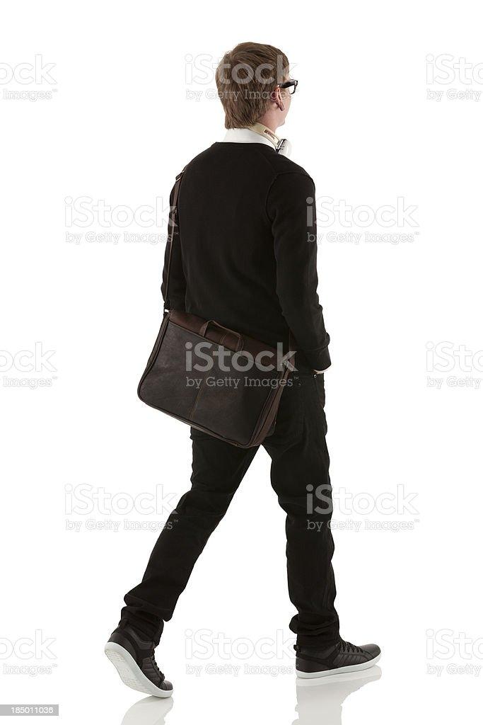 Rear view of a man walking royalty-free stock photo