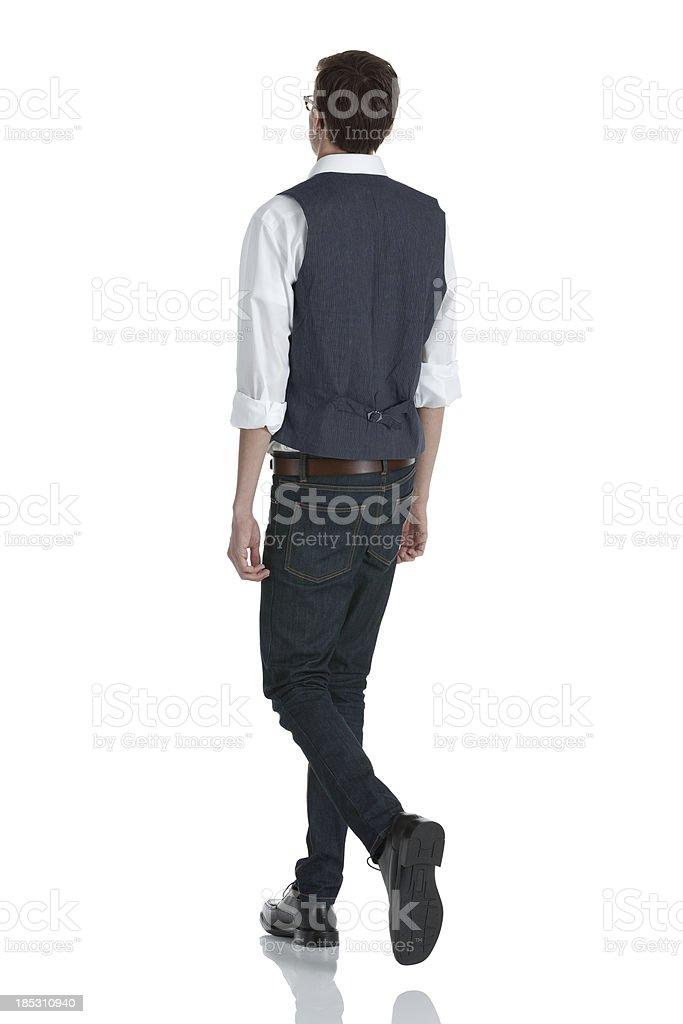 Rear view of a man walking stock photo