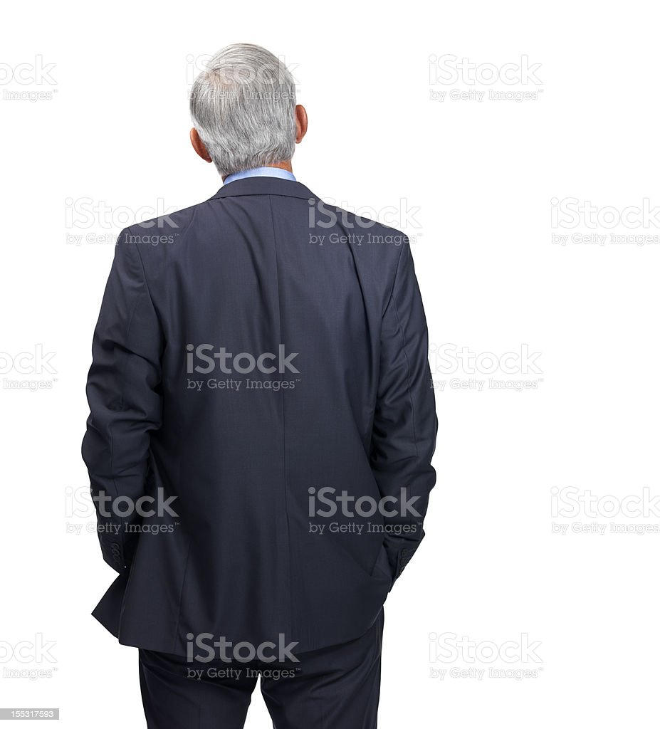 Rear view of a mature businessman in formal attire stock photo