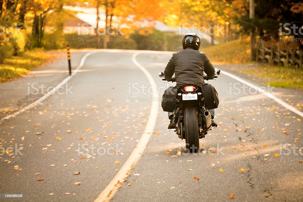 Rear view of a motorcycle rider on the highway stock photo