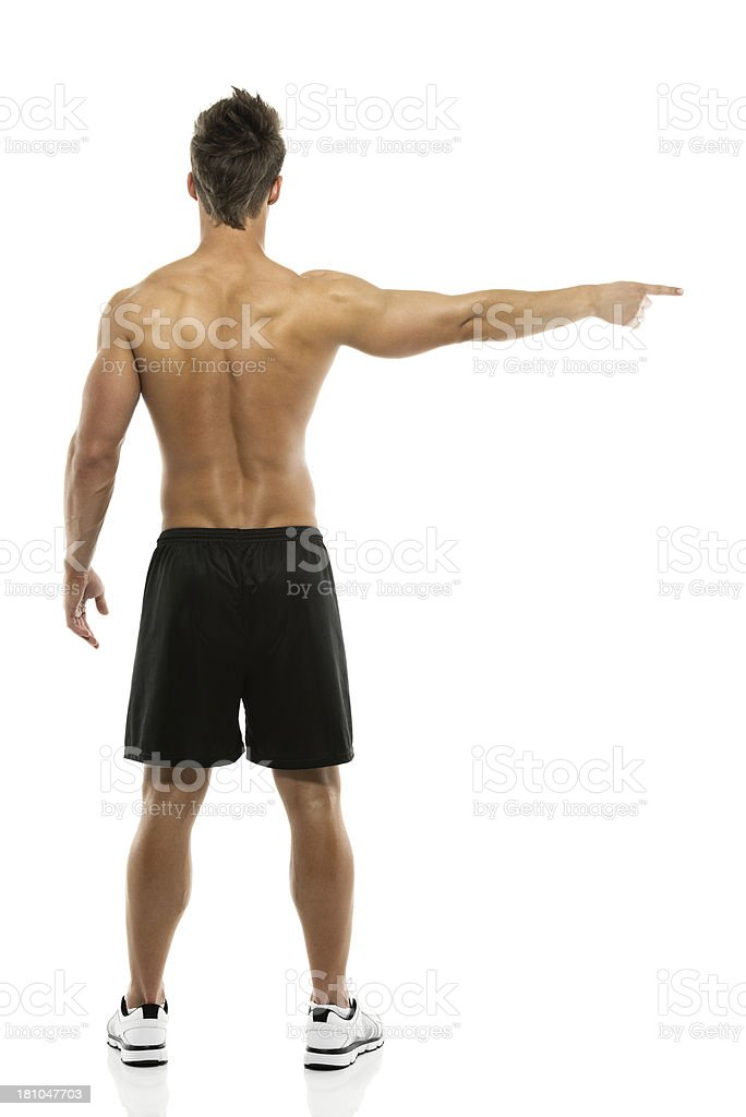 Rear view of a muscular man pointing royalty-free stock photo