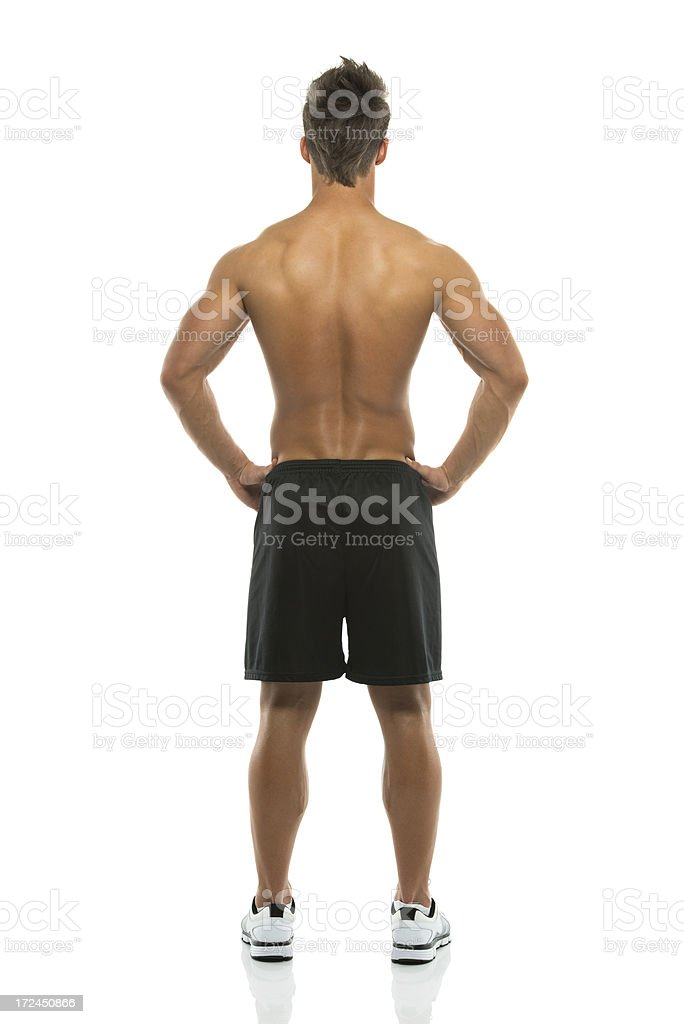 Rear view of a muscular man posing royalty-free stock photo