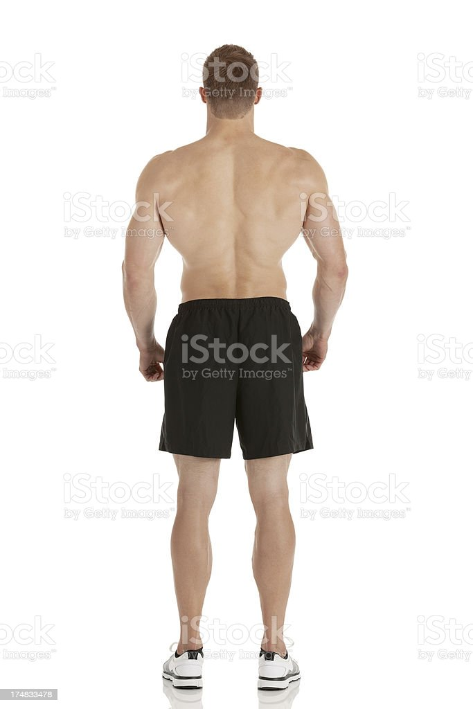 Rear view of a muscular man standing royalty-free stock photo