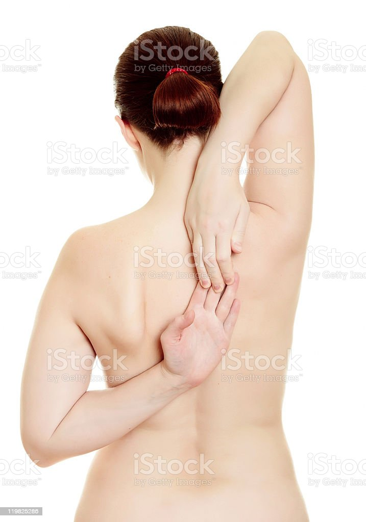 Rear view of a nude female stock photo