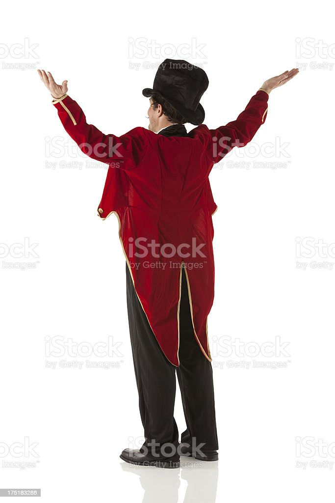 Rear view of a ring master performing stock photo