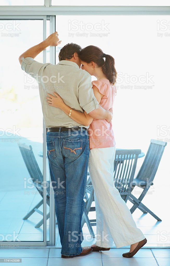 Rear view of a romantic and serene couple by the porch stock photo