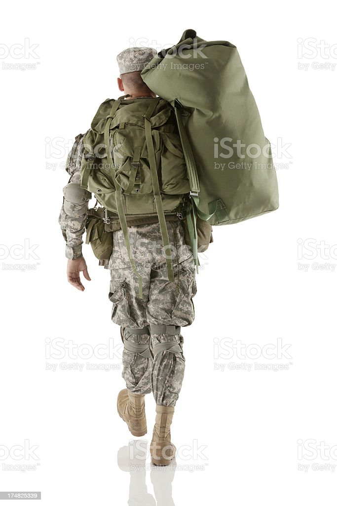 Rear view of a soldier walking royalty-free stock photo