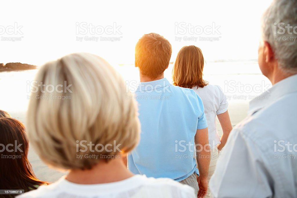 Rear view of a three generational family at the beach royalty-free stock photo