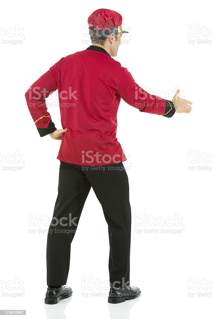 Rear view of a valet offering handshake royalty-free stock photo