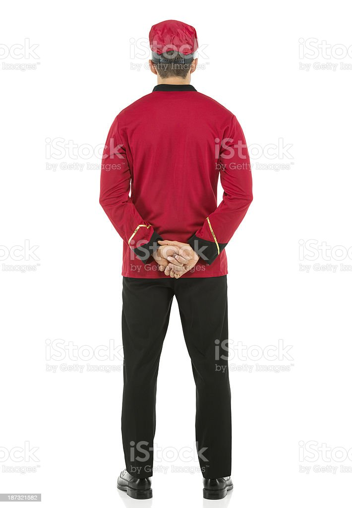 Rear view of a valet standing royalty-free stock photo