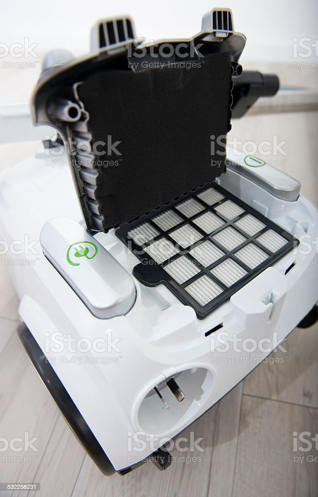 Rear view of a white vacuum cleaner. stock photo