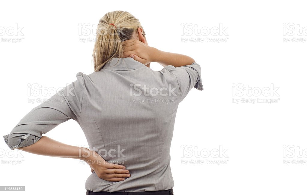 Rear view of a woman holding her back, as if in pain stock photo
