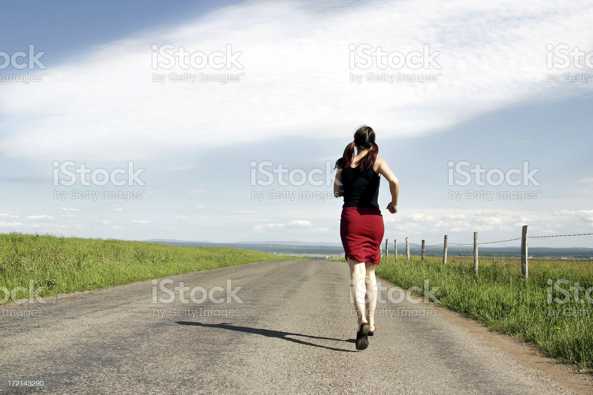 Rear view of a woman running royalty-free stock photo