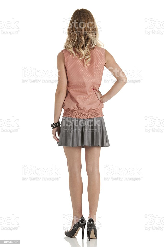 Rear view of a woman standing stock photo