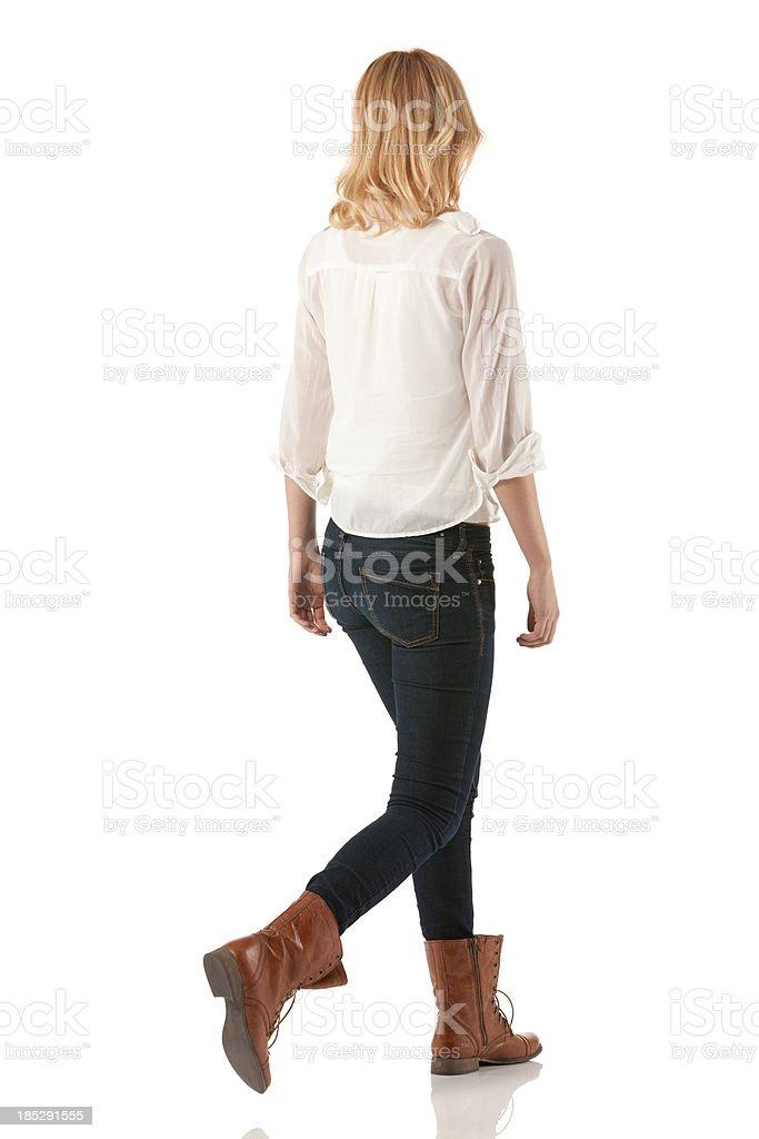 Rear view of a woman walking royalty-free stock photo
