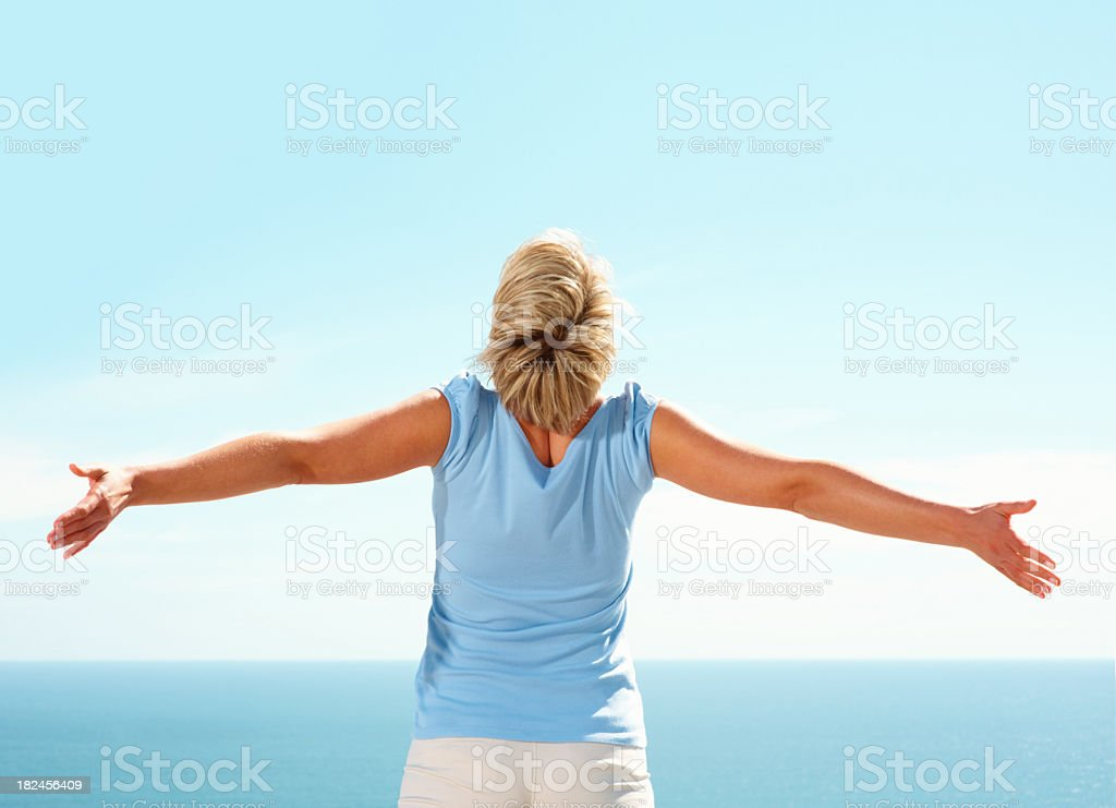 Rear view of a woman with hands outstretched royalty-free stock photo