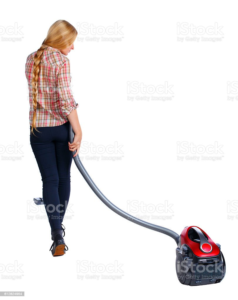 Rear view of a woman with  vacuum cleaner stock photo