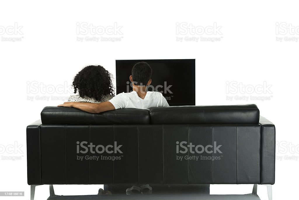 Rear view of a young couple watching television royalty-free stock photo
