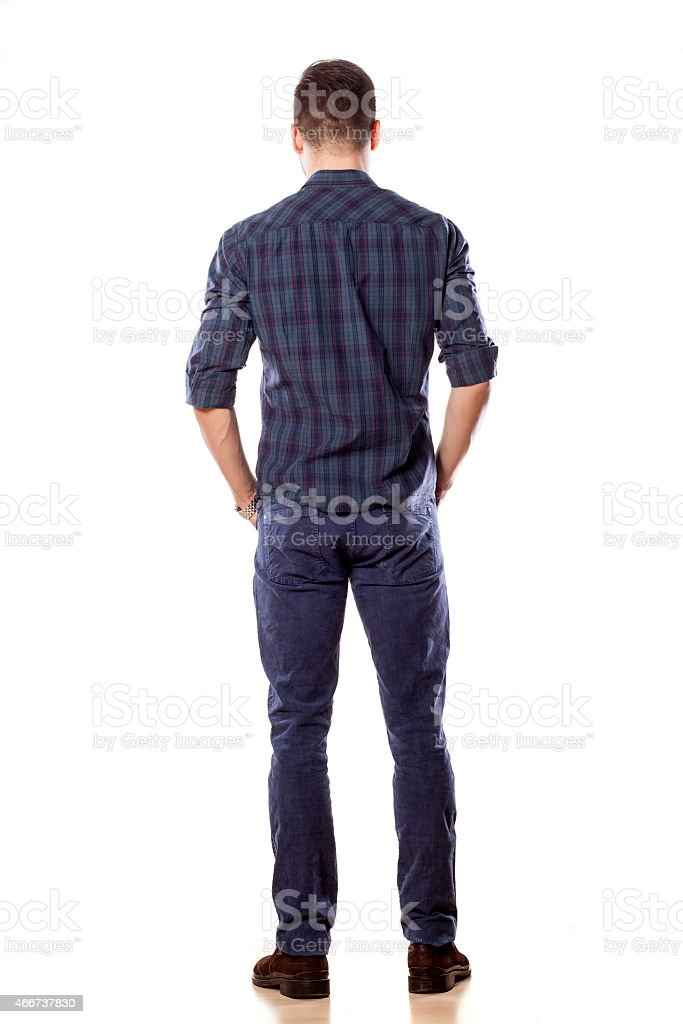 Rear view of a young man in jeans stock photo