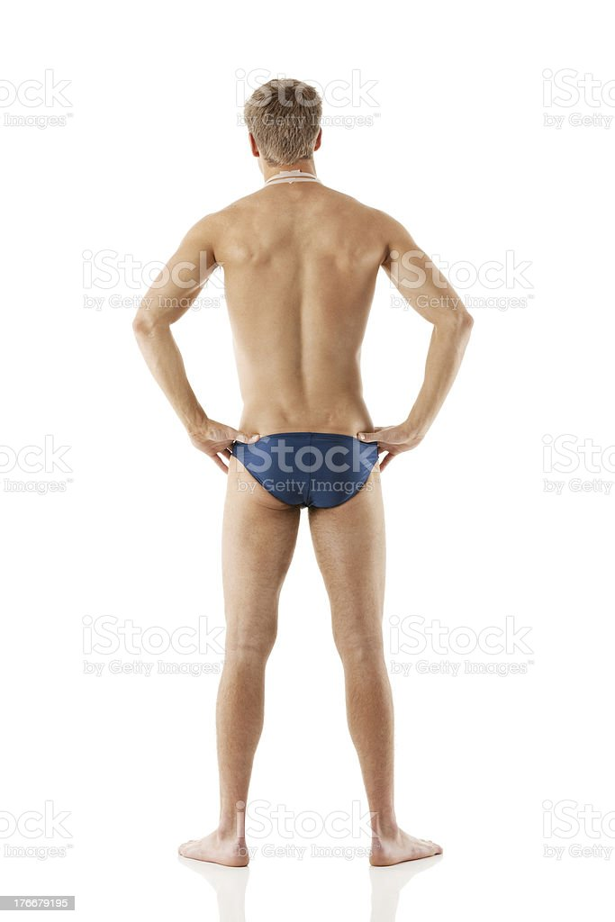 Rear view of a young man in swimwear royalty-free stock photo