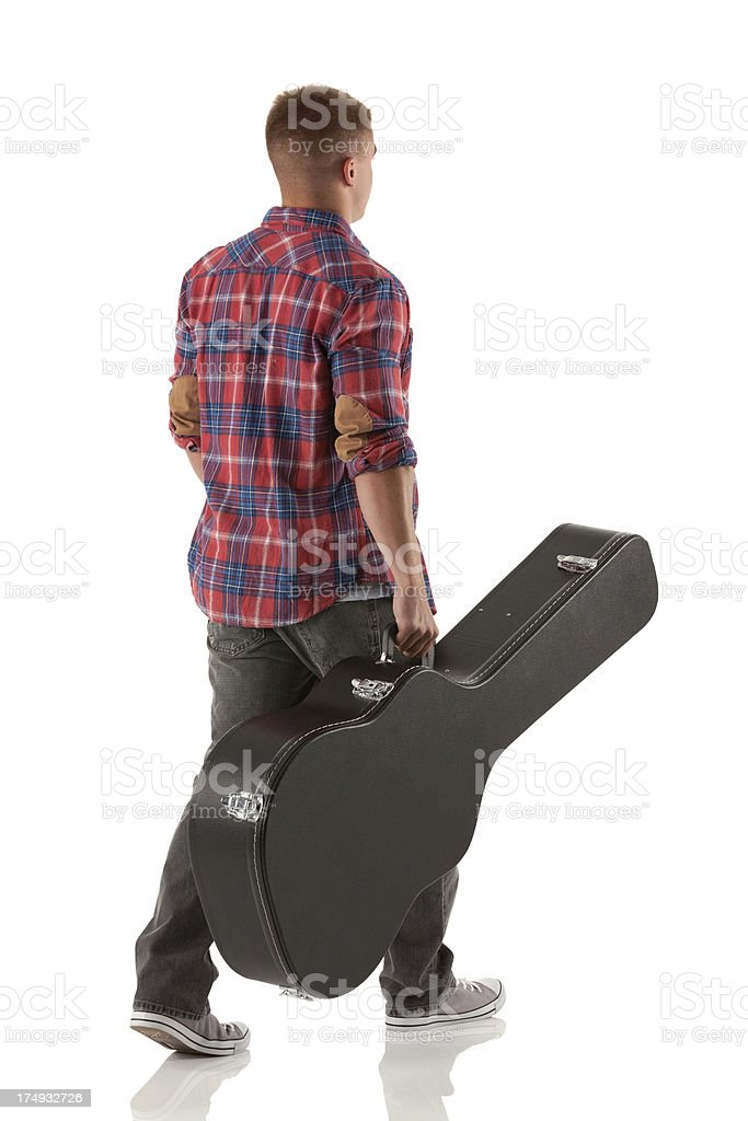 Rear view of a young man with guitar stock photo