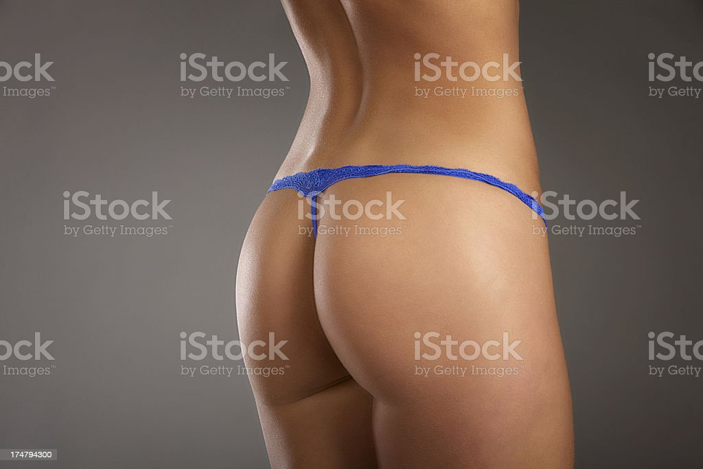 Rear view of a young woman's perfect butt royalty-free stock photo