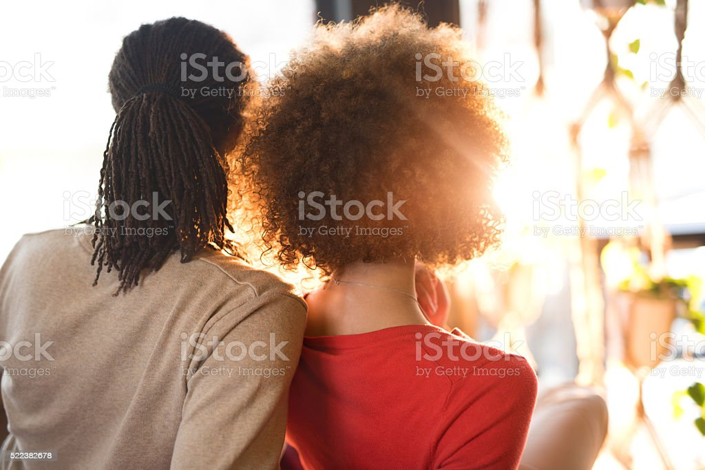 Rear view of African American couple relaxing together. stock photo