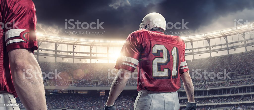 Rear View of American Football Player Heading Onto Pitch stock photo