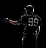 Rear view of American football player pointing