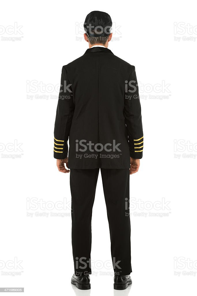 Rear view of an airlines pilot standing royalty-free stock photo