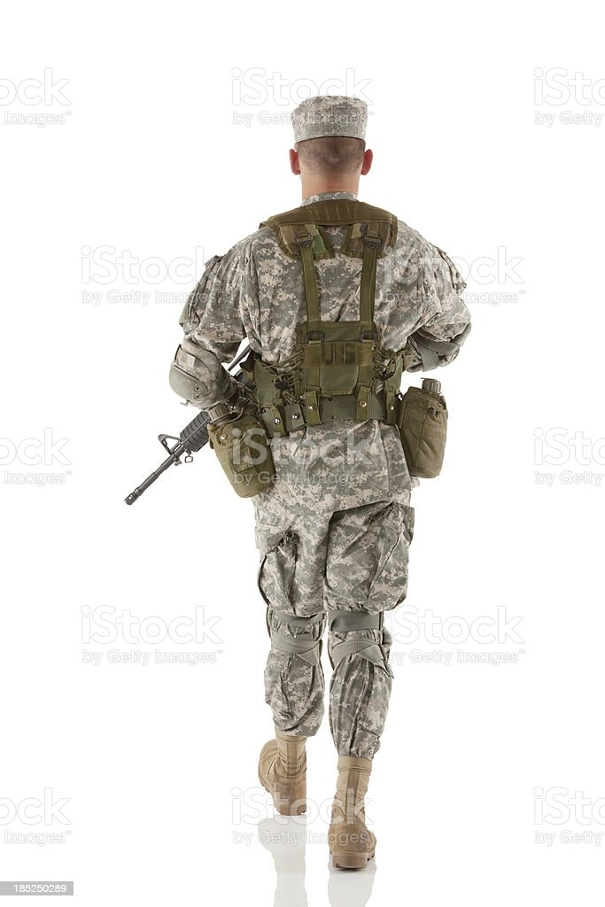 Rear view of an army man walking royalty-free stock photo