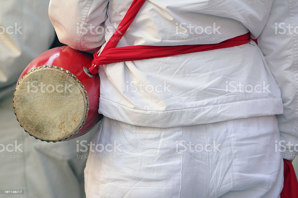 Rear view of an entertainer with red drum. stock photo