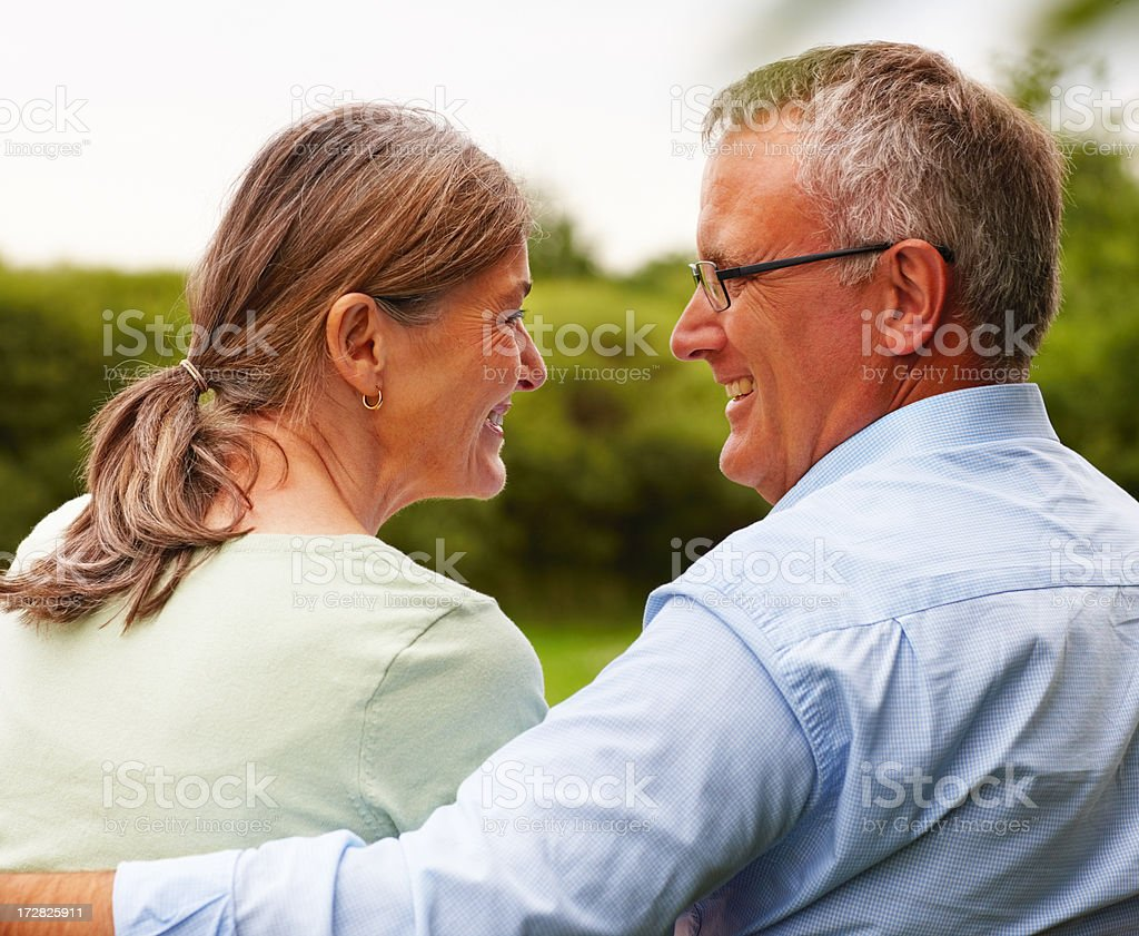 Rear view of an old couple at the park stock photo