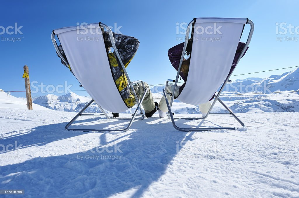 Rear view of apres ski at mountains stock photo