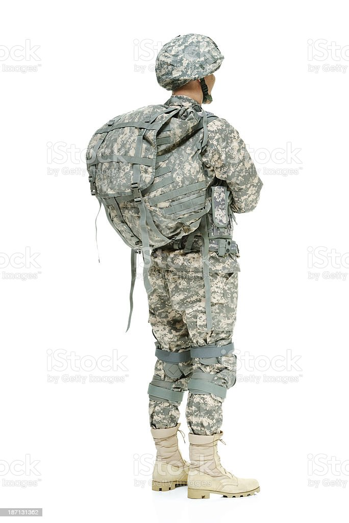 Rear view of army man with arms crossed royalty-free stock photo