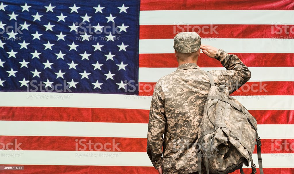 Rear view of army saluting stock photo