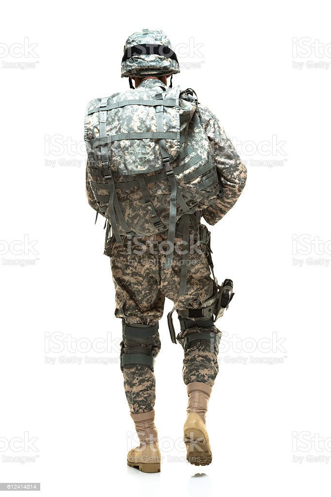 Rear view of army walking stock photo