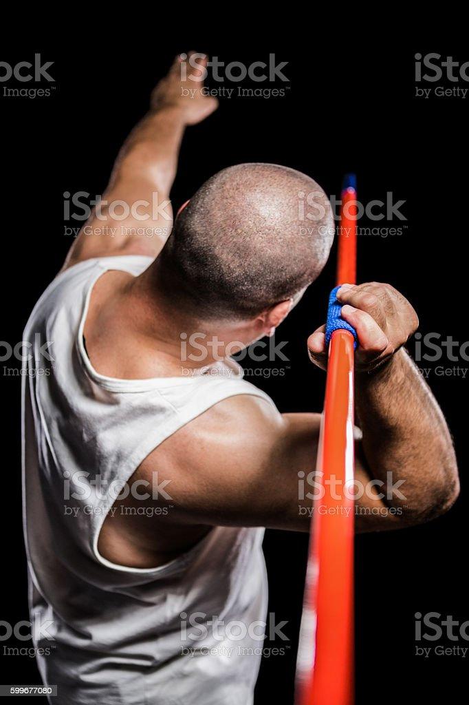 Rear view of athlete preparing to throw javelin stock photo