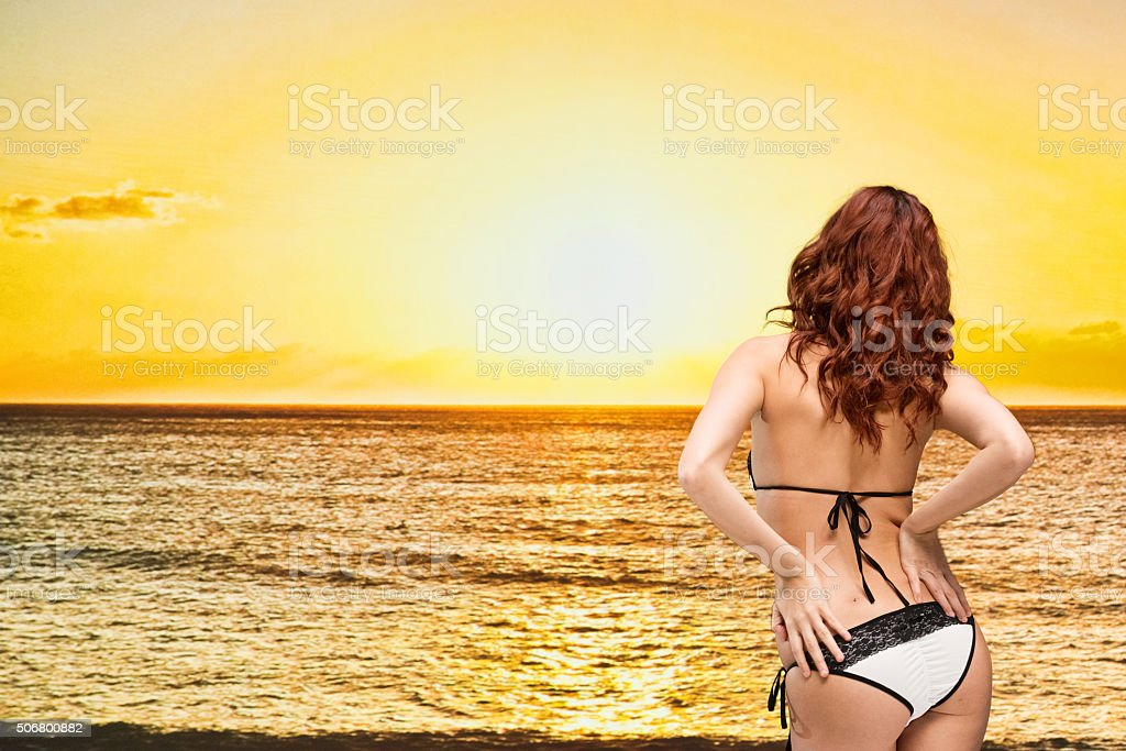 Rear view of attractive woman in the beach stock photo