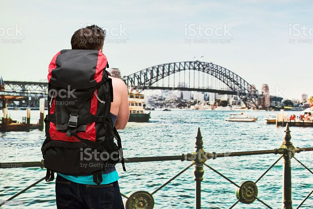 Rear view of backpacker standing outdoors stock photo