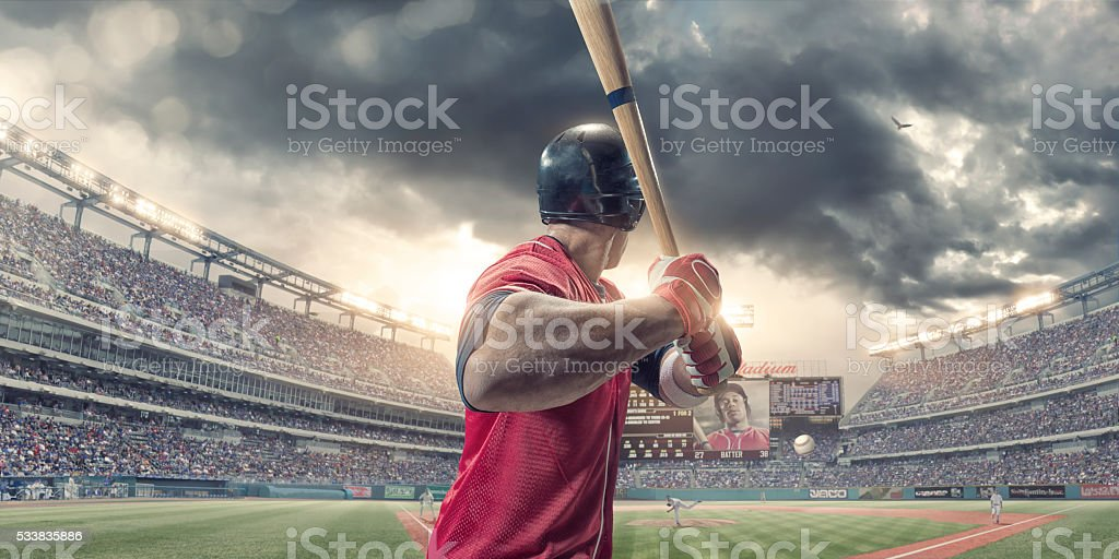 Rear View of Baseball Batter About to Hit During Game stock photo